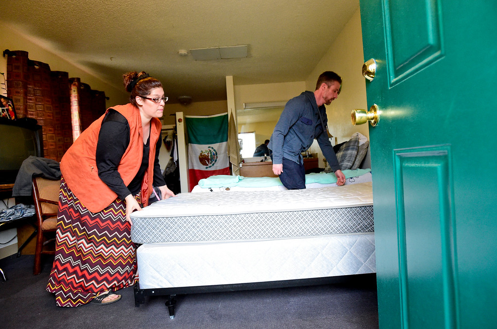 . Emma Gonzales, Community Manager for Briarwood Apartments, and Joel Creel, Probation Supervisor, move another mattress and box springs into a room in Longmont on Tuesday. More photos: TimesCall.com. Matthew Jonas/Staff Photographer March 28,  2017