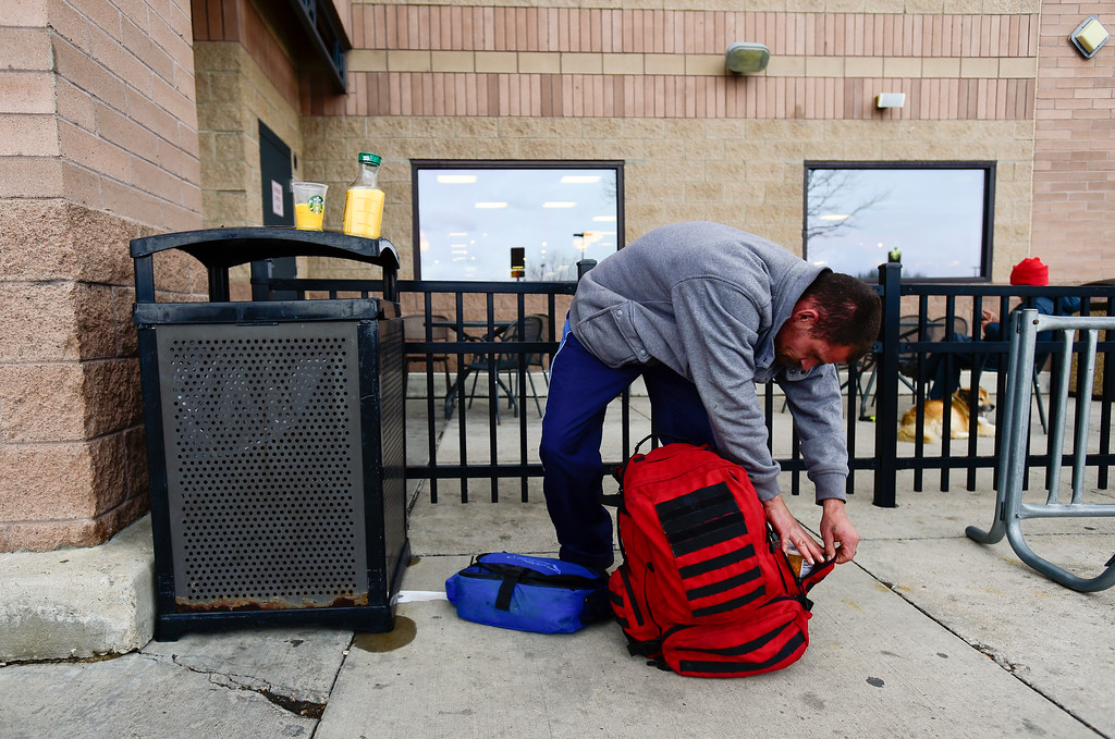 . Glenn Tefft, who is currently homeless in Longmont, packs up his backpack after getting something to eat with his SNAP benefits at King Soopers on Tuesday. Matthew Jonas/Staff Photographer April 4,  2017