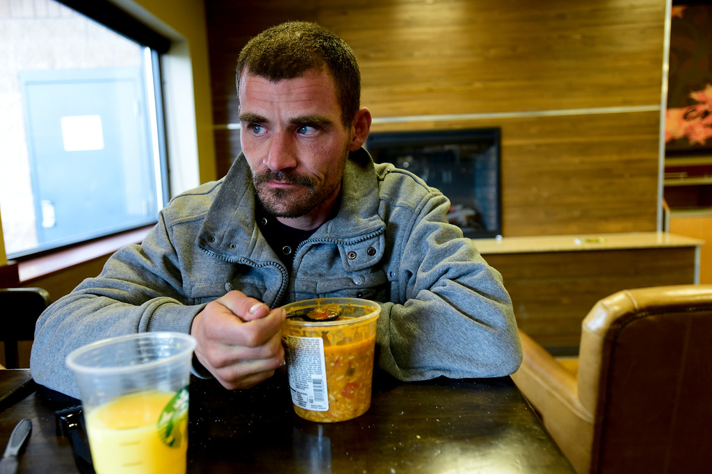 . Glenn Tefft pauses for a moment while sitting at King Soopers on Hover Street eating soup he bought with SNAP benefits on Tuesday. Tefft was offered a job on the night shift at a printing plant in Longmont.  Matthew Jonas/Staff Photographer April 4,  2017
