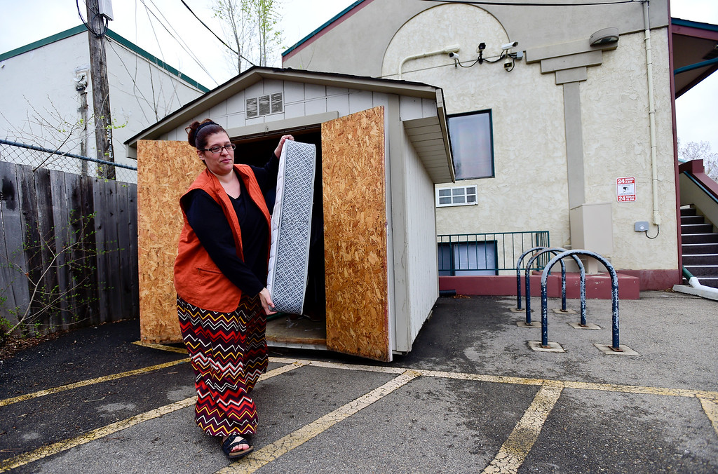 . Emma Gonzales, Community Manager for Briarwood Apartments, and Joel Creel, Probation Supervisor, (not pictured) move a spare mattress and box springs from storage into a room in Longmont on Tuesday. More photos: TimesCall.com. Matthew Jonas/Staff Photographer March 28,  2017