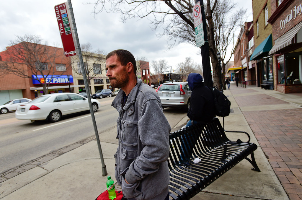 . Glenn Tefft waits for a bus on Main Street on Tuesday. Matthew Jonas/Staff Photographer April 4,  2017