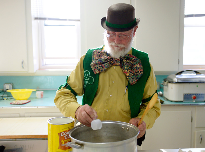 "Andy Ernst makes the lemonade during the St. Patrick's Dinner at Hygiene United Methodist Church, 7542 Hygiene Rd., Wednesday. More than 300 guests were expected to be served for the dinner which the church has been sponsoring for about 15 years. ""This is such a good way to reach out to the community and let them know we are here for them,"" said Pastor Dawnmarie Fiechtner.<br /> Lewis Geyer/Staff Photographer<br /> March 16, 2016"