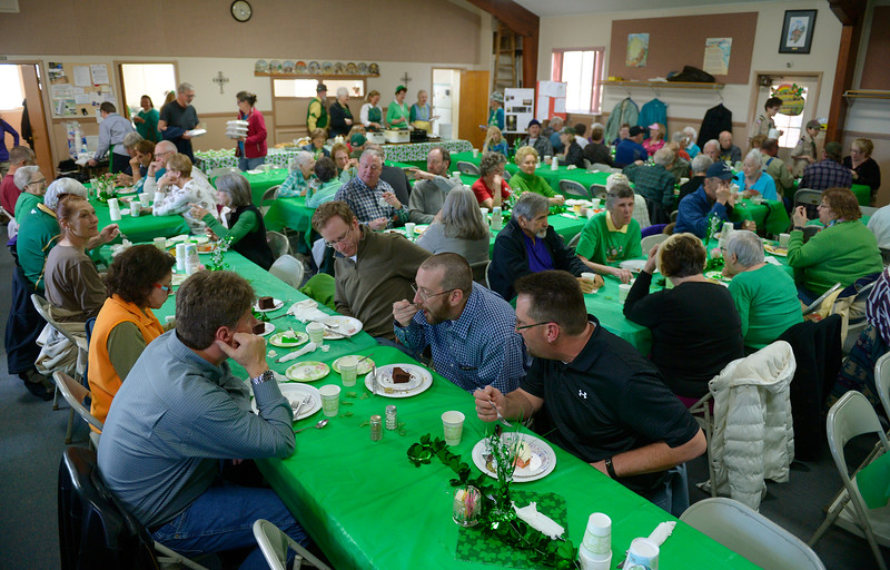 "Guests eat during the St. Patrick's Dinner at Hygiene United Methodist Church, 7542 Hygiene Rd., Wednesday. More than 300 guests were expected to be served for the dinner which the church has been sponsoring for about 15 years. ""This is such a good way to reach out to the community and let them know we are here for them,"" said Pastor Dawnmarie Fiechtner.<br /> Lewis Geyer/Staff Photographer<br /> March 16, 2016"