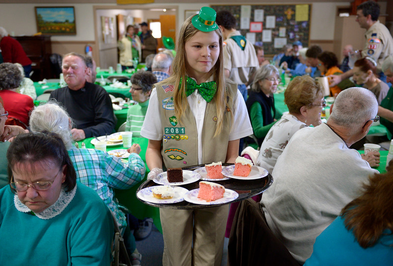 "Girl Scout Haley Jones, 12, offers desserts for diners at the St. Patrick's Dinner at Hygiene United Methodist Church, 7542 Hygiene Rd., Wednesday. More than 300 guests were expected to be served for the dinner which the church has been sponsoring for about 15 years. ""This is such a good way to reach out to the community and let them know we are here for them,"" said Pastor Dawnmarie Fiechtner.<br /> Lewis Geyer/Staff Photographer<br /> March 16, 2016"