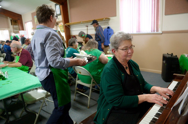 "Janette McKinny plays the piano during the St. Patrick's Dinner at Hygiene United Methodist Church, 7542 Hygiene Rd., Wednesday. More than 300 guests were expected to be served for the dinner which the church has been sponsoring for about 15 years. ""This is such a good way to reach out to the community and let them know we are here for them,"" said Pastor Dawnmarie Fiechtner.<br /> Lewis Geyer/Staff Photographer<br /> March 16, 2016"