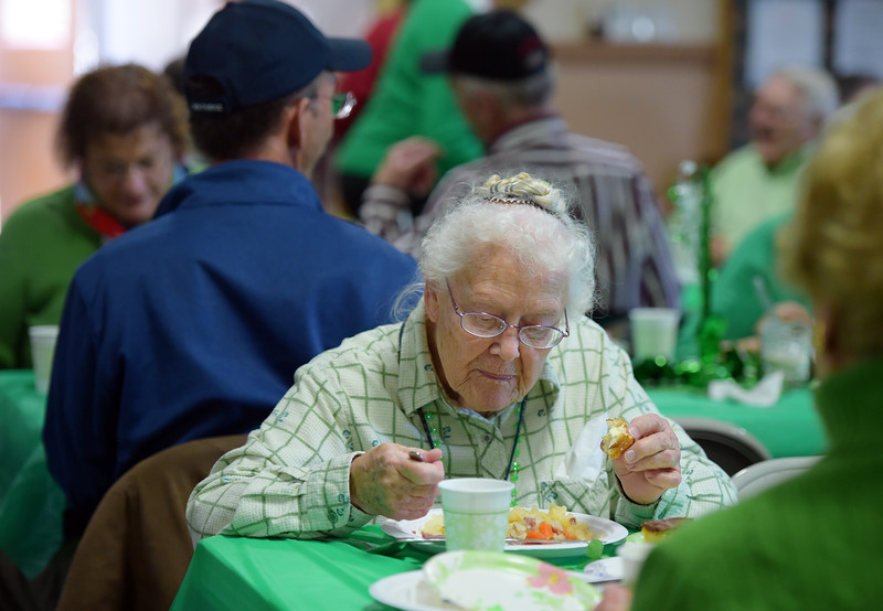 "Dolly Kochheiser, 88, eats during the St. Patrick's Dinner at Hygiene United Methodist Church, 7542 Hygiene Rd., Wednesday. More than 300 guests were expected to be served for the dinner which the church has been hosting for about 15 years. ""This is such a good way to reach out to the community and let them know we are here for them,"" said Pastor Dawnmarie Fiechtner.<br /> Lewis Geyer/Staff Photographer<br /> March 16, 2016"