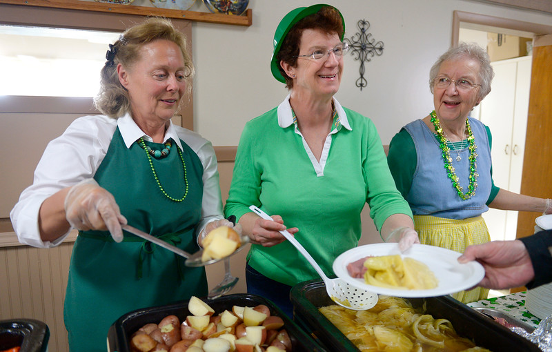 "From left: Cindy Bennett, Diane Swartz, and Linda Gaede serve corned beef, boiled cabbage, potatoes, and carrots, and various desserts during the St. Patrick's Dinner at Hygiene United Methodist Church, 7542 Hygiene Rd., Wednesday. More than 300 guests were expected to be served for the dinner which the church has been sponsoring for about 15 years. ""This is such a good way to reach out to the community and let them know we are here for them,"" said Pastor Dawnmarie Fiechtner.<br /> Lewis Geyer/Staff Photographer<br /> March 16, 2016"