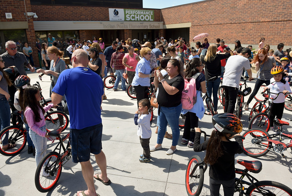 . The CAN\'d Aid Foundation\'s bike giveaway Tuesday afternoon at Indian Peaks Elementary, 1335 S. Judson St. To view more photos visit timescall.com. Lewis Geyer/Staff Photographer May 15, 2018
