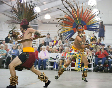 Kalto Cruz-Chavez, right, and Tanner Villegas of Tezkatlipoka Aztec Dance and Drum of San Jose perform at the 37th-annual Intertribal Gathering and Elders Dinner at Redwood Acres Fairgrounds in Eureka on Saturday. The event included a ceremony honoring elders and veterans, turkey and salmon dinner, drumming, dance demonstrations, and vendors. (Shaun Walker -- The Times-Standard)