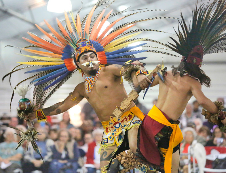 Kalto Cruz-Chavez, left, and Tanner Villegas of Tezkatlipoka Aztec Dance and Drum of San Jose perform at the 37th-annual Intertribal Gathering and Elders Dinner at Redwood Acres Fairgrounds in Eureka on Saturday. The event included a ceremony honoring elders and veterans, turkey and salmon dinner, drumming, dance demonstrations, and vendors. (Shaun Walker -- The Times-Standard)