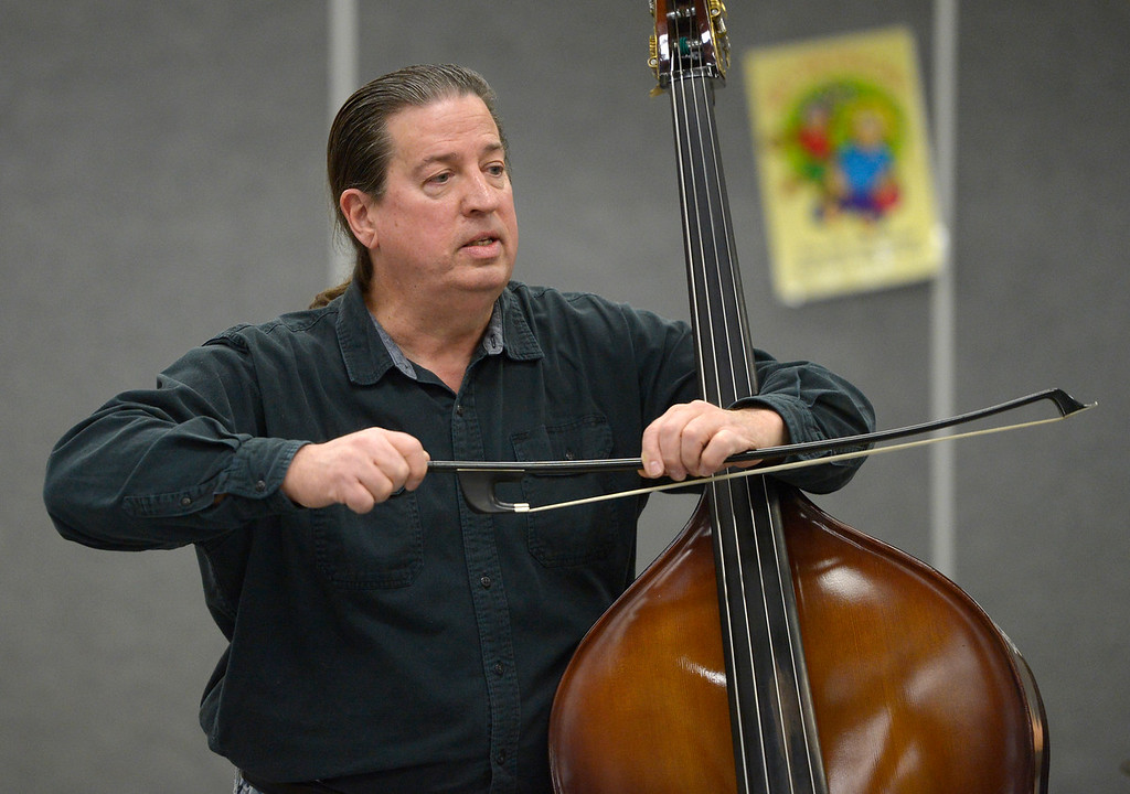 . NIWOT, CO - JANUARY 11: Andy Hall talks about using a bow with his bass during a jazz performance January 11, 2019 at Niwot Elementary School. (Photo by Lewis Geyer/Staff Photographer)