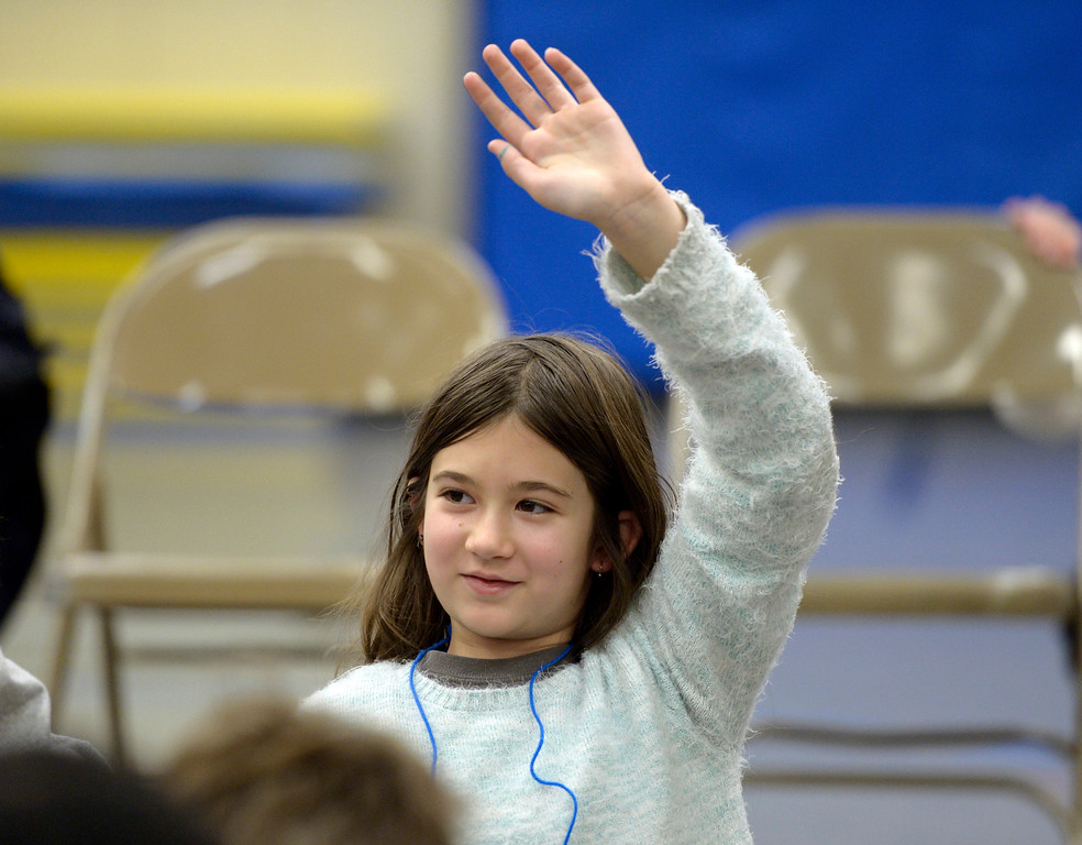 . NIWOT, CO - JANUARY 11: Fifth grader Beverly Orr raises her hand to ask a question while a jazz quintet was performing January 11, 2019 at Niwot Elementary School. (Photo by Lewis Geyer/Staff Photographer)