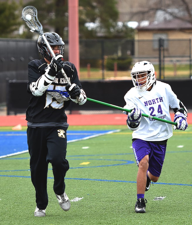 . Jefferson Academy\'s Hunter Rodman looks for a teammate during the Jaguars\' game against Denver North on Friday, April 13, at All-City Stadium in Denver.