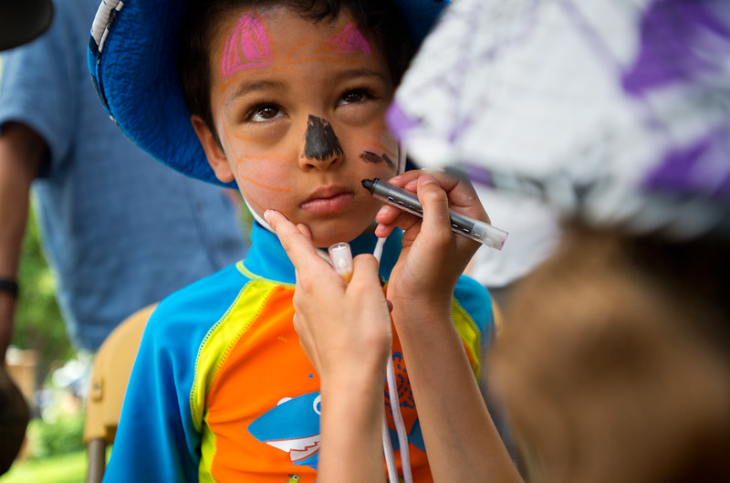 "Kaya Surden, 8, paints the face of Alex Estrella, 4, during the Jewish Festival at the Pearl Street Mall in Boulder on Sunday.<br /> More photos:  <a href=""http://www.dailycamera.com"">http://www.dailycamera.com</a><br /> (Autumn Parry/Staff Photographer)<br /> June 19, 2016"