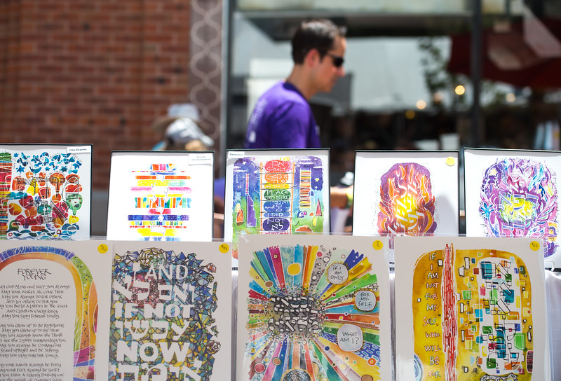 "Prints of watercolor calligraphy by Risa Aqua sit on display during the Jewish Festival at the Pearl Street Mall in Boulder on Sunday.<br /> More photos:  <a href=""http://www.dailycamera.com"">http://www.dailycamera.com</a><br /> (Autumn Parry/Staff Photographer)<br /> June 19, 2016"