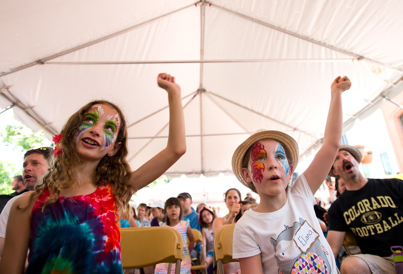 "Kaya Surden, 8, and Eliana Monahan, 9, cheer as they sing along with ""Jeff & Paige"" during the Jewish Festival at the Pearl Street Mall in Boulder on Sunday.<br /> More photos:  <a href=""http://www.dailycamera.com"">http://www.dailycamera.com</a><br /> (Autumn Parry/Staff Photographer)<br /> June 19, 2016"