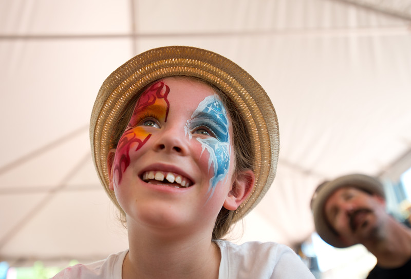 "Eliana Monahan, 9, watches ""Jeff & Paige"" perform, as they sing about science and nature during the Jewish Festival at the Pearl Street Mall in Boulder on Sunday.<br /> More photos:  <a href=""http://www.dailycamera.com"">http://www.dailycamera.com</a><br /> (Autumn Parry/Staff Photographer)<br /> June 19, 2016"