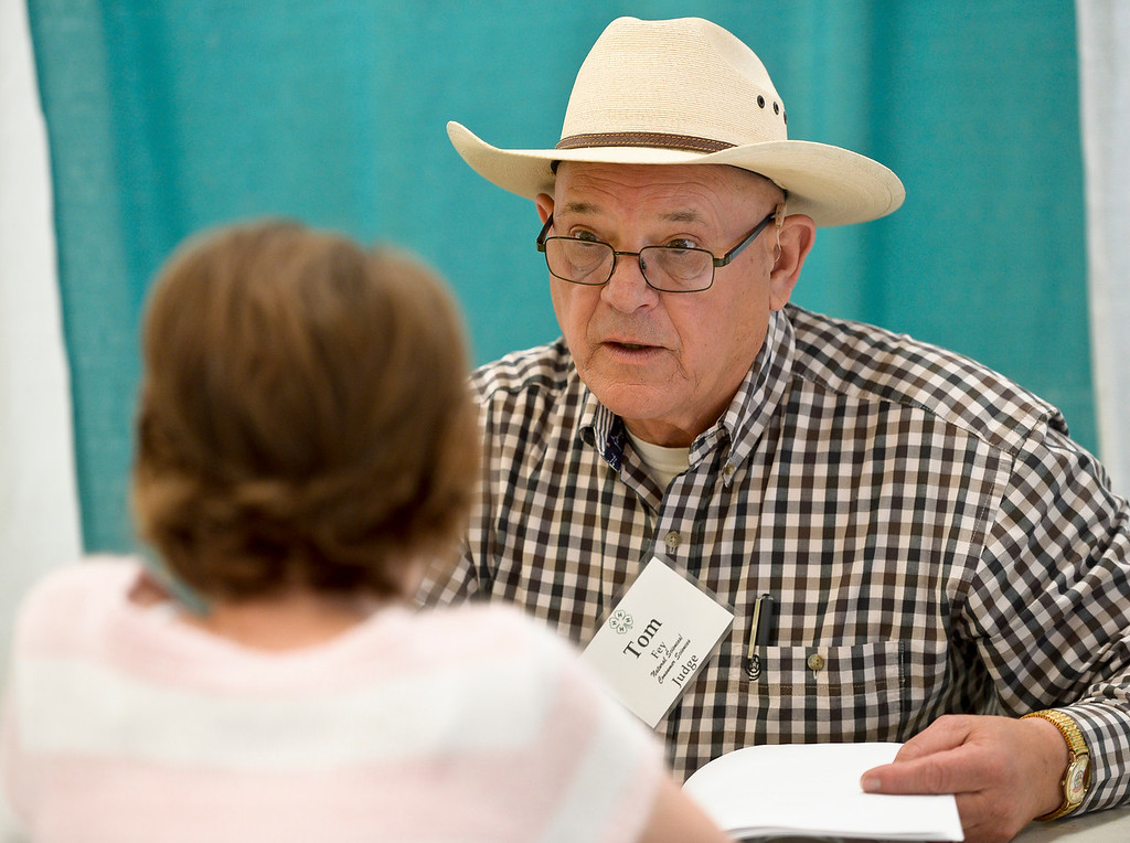 . Millicent Garcia Meiring, 13, of Firestone, is interviewed by project judge Tom Fey during 4-H interview judging in the Exhibit Building Thursday morning. Garcia Meiring is a member of the Critters and Creations 4-H Club. To view more photos visit timescall.com. (Photo by Lewis Geyer/Staff Photographer) August 02, 2018