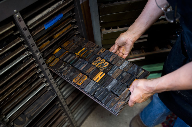 "Julia Seko looks through her wooden type before printing proofs on her Vandercook letterpress at her home in Longmont on Saturday. <br /> More photos:  <a href=""http://www.dailycamera.com"">http://www.dailycamera.com</a><br /> (Autumn Parry/Staff Photographer)<br /> September 3, 2016"