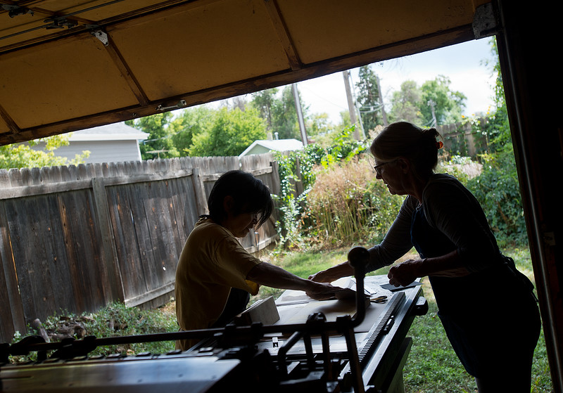 "Julia Seko helps her friend, Vivian Jean, make proofs using a Vandercook letterpress at her home in Longmont on Saturday. <br /> More photos:  <a href=""http://www.dailycamera.com"">http://www.dailycamera.com</a><br /> (Autumn Parry/Staff Photographer)<br /> September 3, 2016"