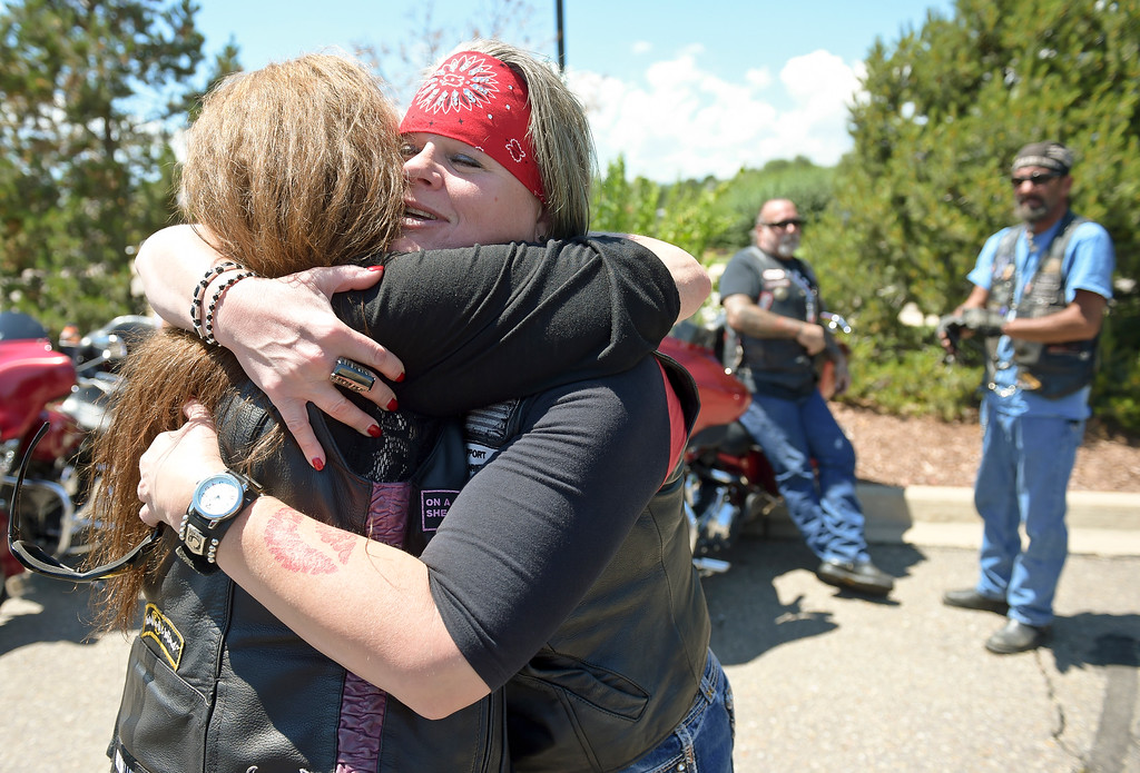 . Kristen Rice, right, of Fort Collins, hugs Sassy Smith, of Loveland, before the Keith Williams memorial ride to Howe Mortuary Friday afternoon. To view more photos and a video visit timescall.com. Lewis Geyer/Staff Photographer July 28, 2017
