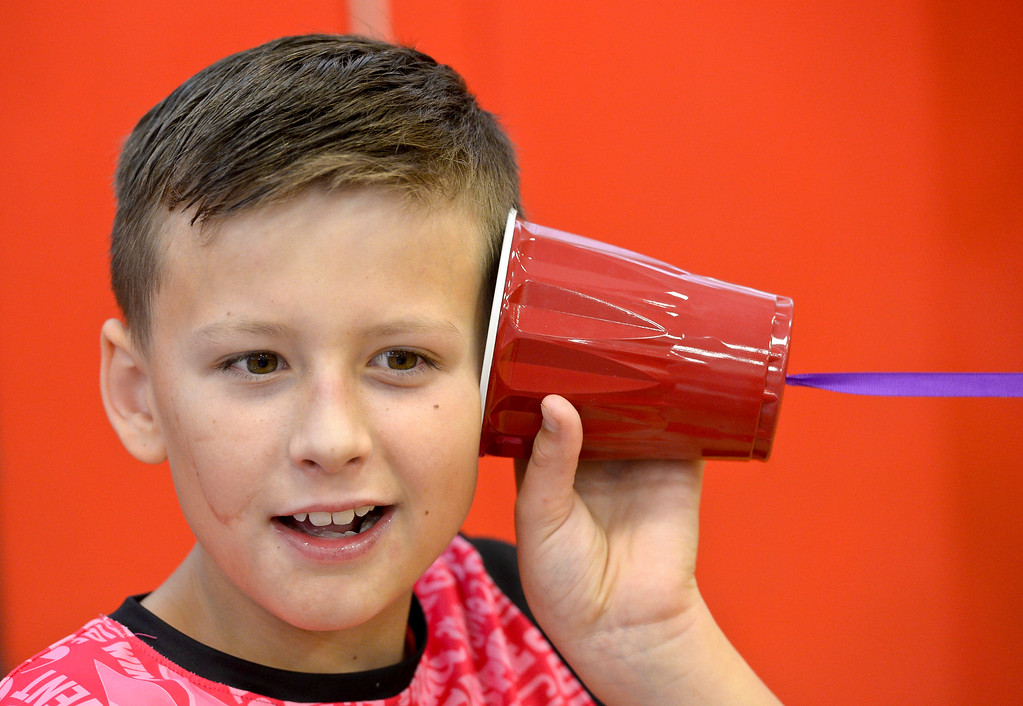 . Fourth grader Landon Vela holds a Solo cup to his ear during CSU\'s Little Shop of Physics Thursday morning at Central Elementary, 1020 Fourth Ave. To view more photos and a video visit timescall.com. Lewis Geyer/Staff Photographer April 12, 2018