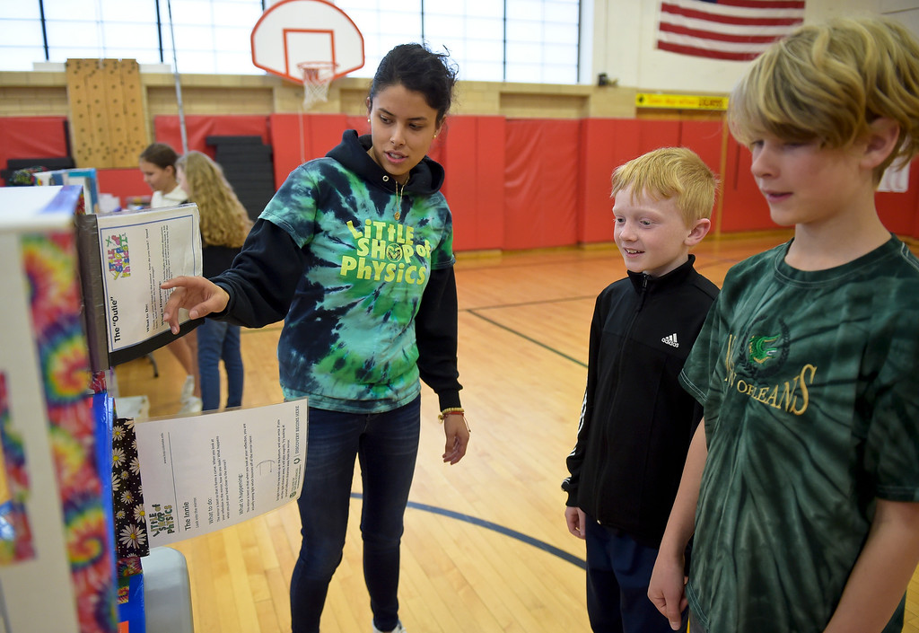 . Intern Rosa Chavez helps fourth graders Ignacio Ready, center, and Logan Johnston with a mirrors exhibit during CSU\'s Little Shop of Physics Thursday morning at Central Elementary, 1020 Fourth Ave. To view more photos and a video visit timescall.com. Lewis Geyer/Staff Photographer April 12, 2018