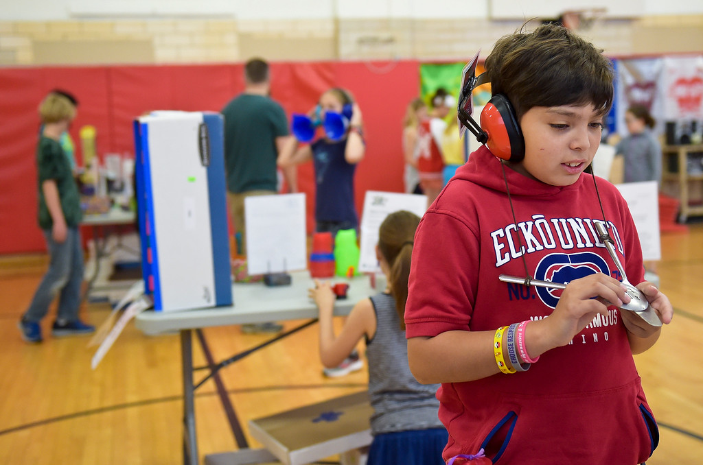 . Fourth grader Rigo Martinez wears a special pair of headphones during CSU\'s Little Shop of Physics Thursday morning at Central Elementary, 1020 Fourth Ave. To view more photos and a video visit timescall.com. Lewis Geyer/Staff Photographer April 12, 2018