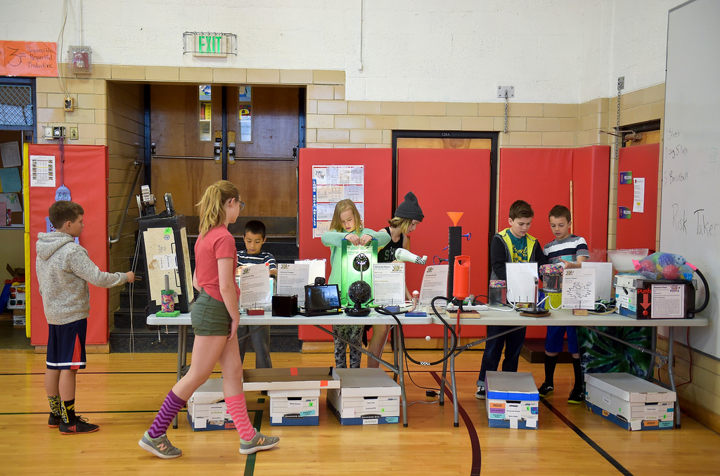 . Fourth graders try out various activities at one of several tables during CSU\'s Little Shop of Physics Thursday morning at Central Elementary, 1020 Fourth Ave. To view more photos and a video visit timescall.com. Lewis Geyer/Staff Photographer April 12, 2018