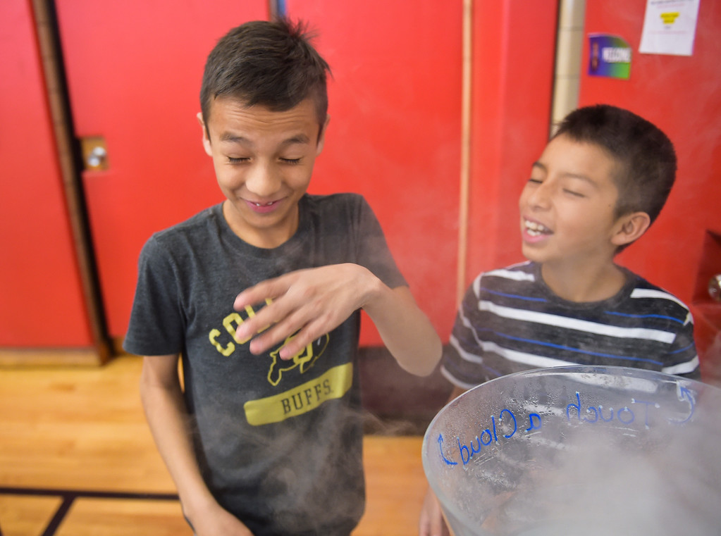 ". Fourth grader Emilio Manjarrez reacts, as classmate Axel Moreno watches, to blowing a ""cloud\"" into his face during CSU\'s Little Shop of Physics Thursday morning at Central Elementary, 1020 Fourth Ave. To view more photos and a video visit timescall.com. Lewis Geyer/Staff Photographer April 12, 2018"