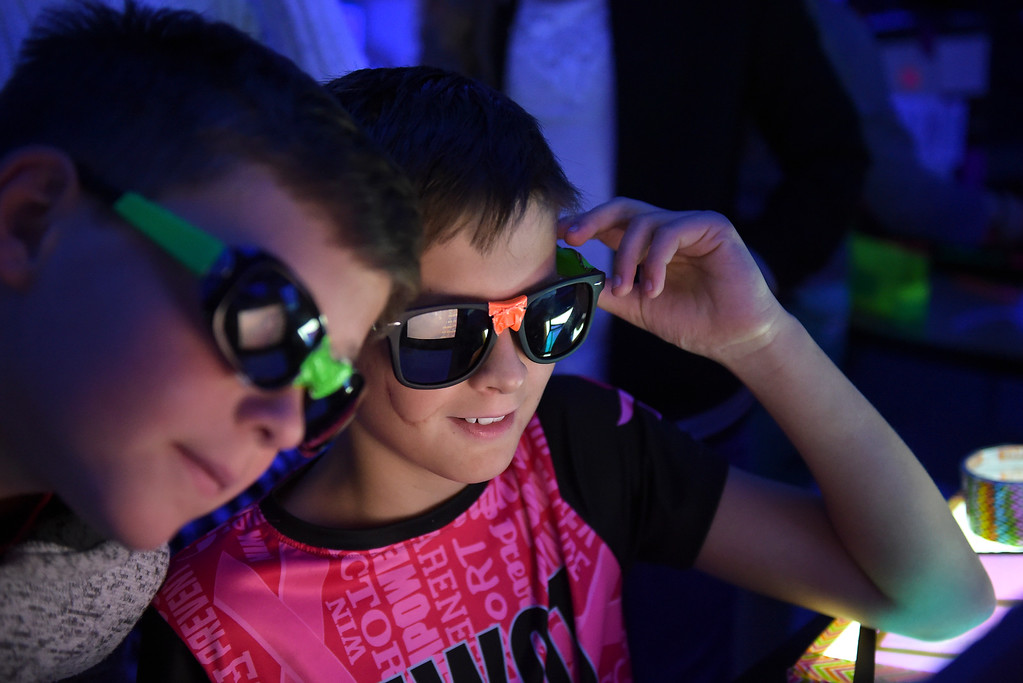 . Fourth graders Max MaKinney, left, and Landon Vela look through special glasses during CSU\'s Little Shop of Physics Thursday morning at Central Elementary, 1020 Fourth Ave. To view more photos and a video visit timescall.com. Lewis Geyer/Staff Photographer April 12, 2018