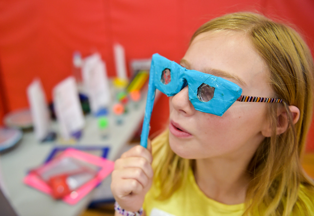 . Fourth grader Clara Linder looks through a pair of kaleidoscope glasses during CSU\'s Little Shop of Physics Thursday morning at Central Elementary, 1020 Fourth Ave. To view more photos and a video visit timescall.com. Lewis Geyer/Staff Photographer April 12, 2018