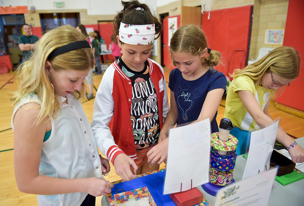 . From left: Fourth graders Emma Payne, Cielo Gartenann, Olivia Benjaminson and Clara Linder get their hands on exhibits at CSU\'s Little Shop of Physics Thursday morning at Central Elementary, 1020 Fourth Ave. To view more photos and a video visit timescall.com. Lewis Geyer/Staff Photographer April 12, 2018