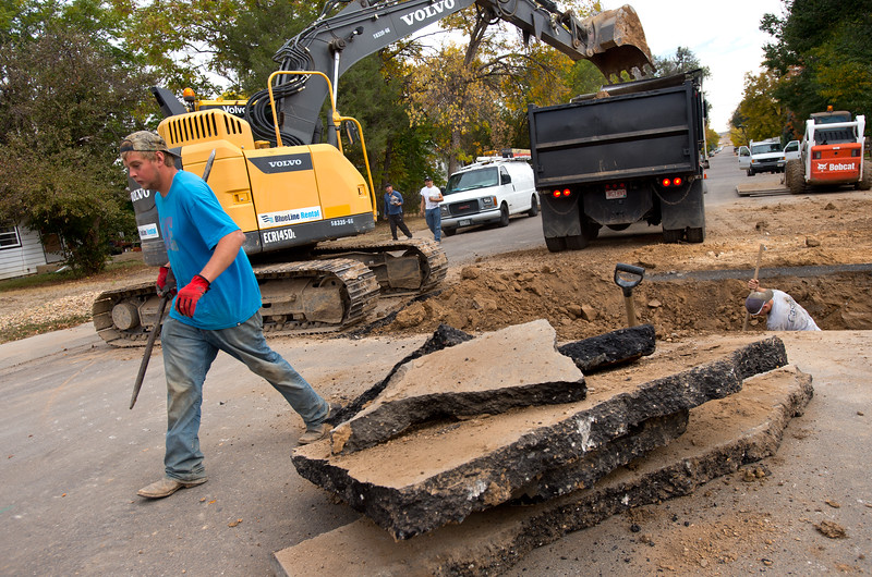 """Luke Alps, a sub contractor, helps dig around a gas line as they prepare to put in sewer lines for new duplexes in Lafayette on Friday. Lafayette City Council will vote to approve an emergency ordinance on Tuesday to establish a moratorium on all new construction in Old Town for the next year. <br /> More photos:  <a href=""""http://www.dailycamera.com"""">http://www.dailycamera.com</a><br /> (Autumn Parry/Staff Photographer)<br /> October 14, 2016"""