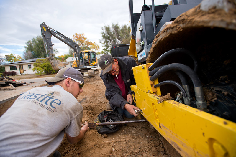 "James Burgess, owner and operator of Rocky Mountain Lateral, adjusts the rolling compactor, with the help of Zack Brown (left) as they work to put in sewer lines for new duplexes in Lafayette on Friday. Lafayette City Council will vote to approve an emergency ordinance on Tuesday to establish a moratorium on all new construction in Old Town for the next year. <br /> More photos:  <a href=""http://www.dailycamera.com"">http://www.dailycamera.com</a><br /> (Autumn Parry/Staff Photographer)<br /> October 14, 2016"