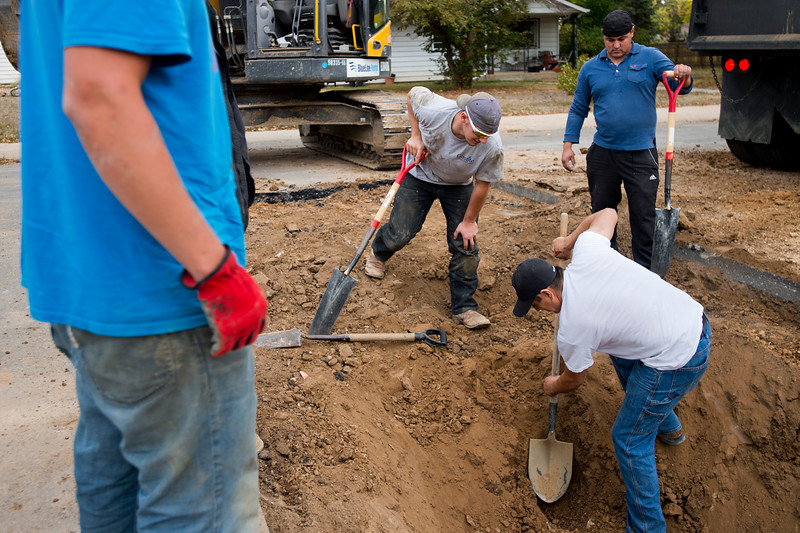 "From left to right, Zack Brown, Antonio Lopez, and Sebastian Dominguez dig around a gas line as they prepare to put in sewer lines for new duplexes in Lafayette on Friday. Lafayette City Council will vote to approve an emergency ordinance on Tuesday to establish a moratorium on all new construction in Old Town for the next year. <br /> More photos:  <a href=""http://www.dailycamera.com"">http://www.dailycamera.com</a><br /> (Autumn Parry/Staff Photographer)<br /> October 14, 2016"