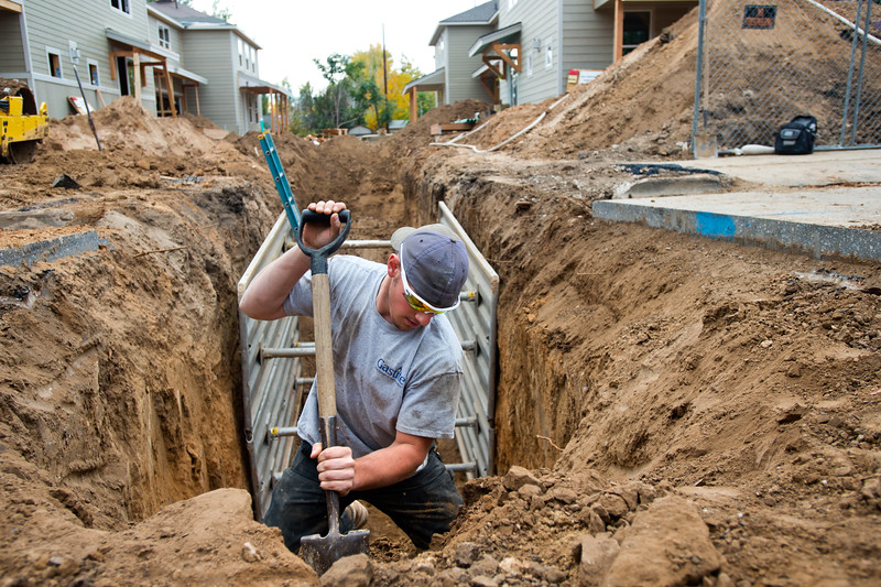 "Zack Brown, a plumbing technician, digs around a gas line as he prepares to put in sewer lines for new duplexes in Lafayette on Friday. Lafayette City Council will vote to approve an emergency ordinance on Tuesday to establish a moratorium on all new construction in Old Town for the next year. <br /> More photos:  <a href=""http://www.dailycamera.com"">http://www.dailycamera.com</a><br /> (Autumn Parry/Staff Photographer)<br /> October 14, 2016"