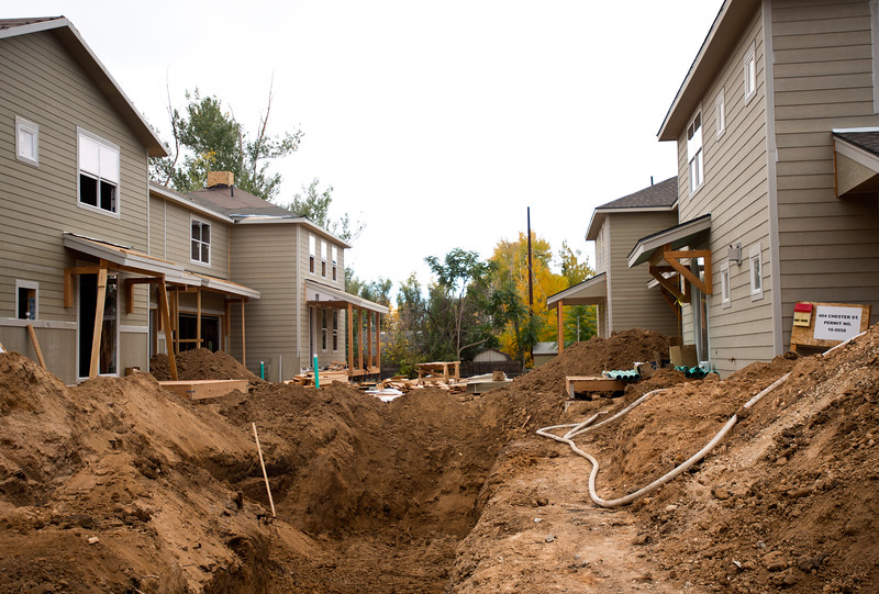 """Rocky Mountain Lateral works to put in sewer lines for new duplexes in Lafayette on Friday. Lafayette City Council will vote to approve an emergency ordinance on Tuesday to establish a moratorium on all new construction in Old Town for the next year. <br /> More photos:  <a href=""""http://www.dailycamera.com"""">http://www.dailycamera.com</a><br /> (Autumn Parry/Staff Photographer)<br /> October 14, 2016"""