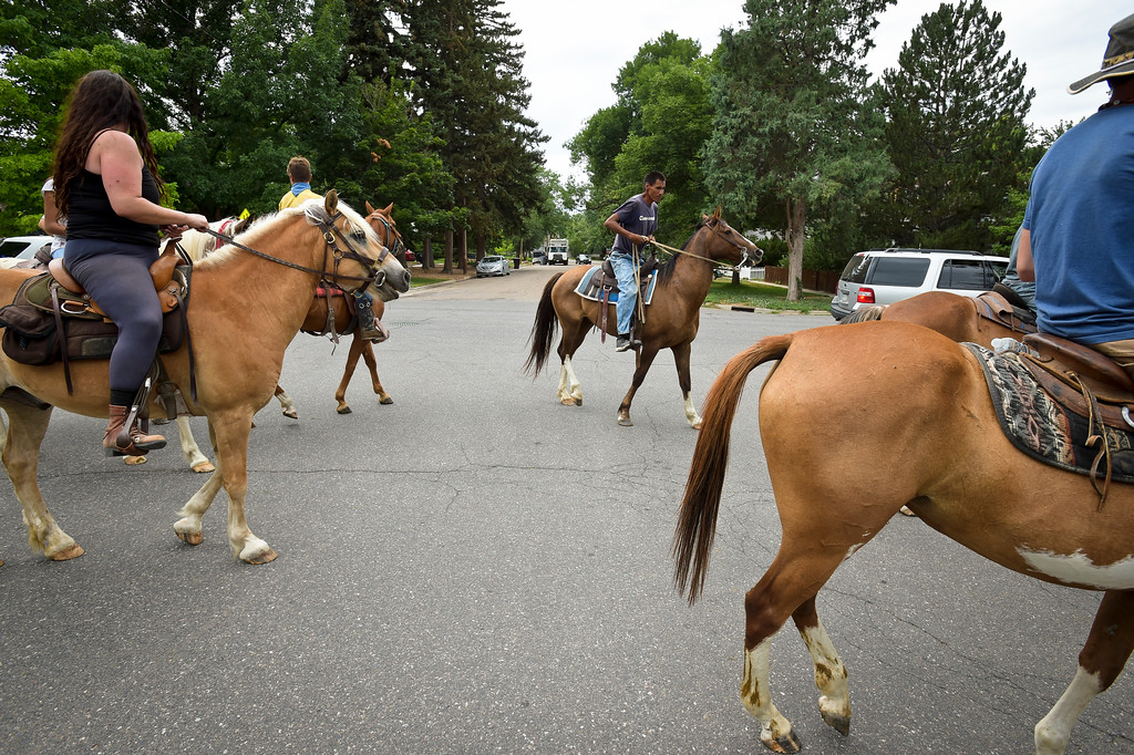. Riders cross Fifth Avenue as they head north on Gay Street during the Lakota Ride 2017 which passed through Longmont Tuesday. The 400-mile ride, which started in Golden Saturday, raises money and awareness for families living on the Pine Ridge Reservation in South Dakota. It is expected to end at the reservation in mid August. To view more photos and a video visit timescall.com. Lewis Geyer/Staff Photographer July 25, 2017