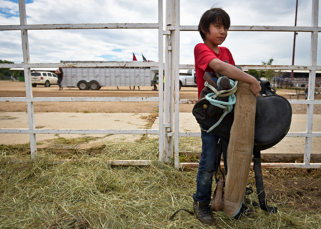 . Levi Rouillard, 9, helps saddle horses for the next leg of Lakota Ride 2017 at the Boulder County Fairgrounds Tuesday. The 400-mile ride, which started in Golden Saturday, raises money and awareness for families living on the Pine Ridge Reservation in South Dakota. It is expected to end at the reservation in mid August. To view more photos and a video visit timescall.com. Lewis Geyer/Staff Photographer July 25, 2017