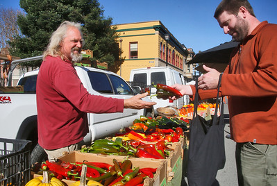 Greg Hall of Eureka buys Anaheim and poblano peppers from Dean Gilkerson of Maple Creek's Earth-N-Hands Farm at the last Old Town Eureka farmers market of the season on Tuesday. The last 2018 Henderson Center market is Thursday from 10 a.m. to 1 p.m., followed by the McKinleyville market in the Eureka Natural Foods parking lot tomorrow from 3:30 to 6:30 p.m. The Saturday Arcata Plaza version is year-round. (Shaun Walker -- The Times-Standard)