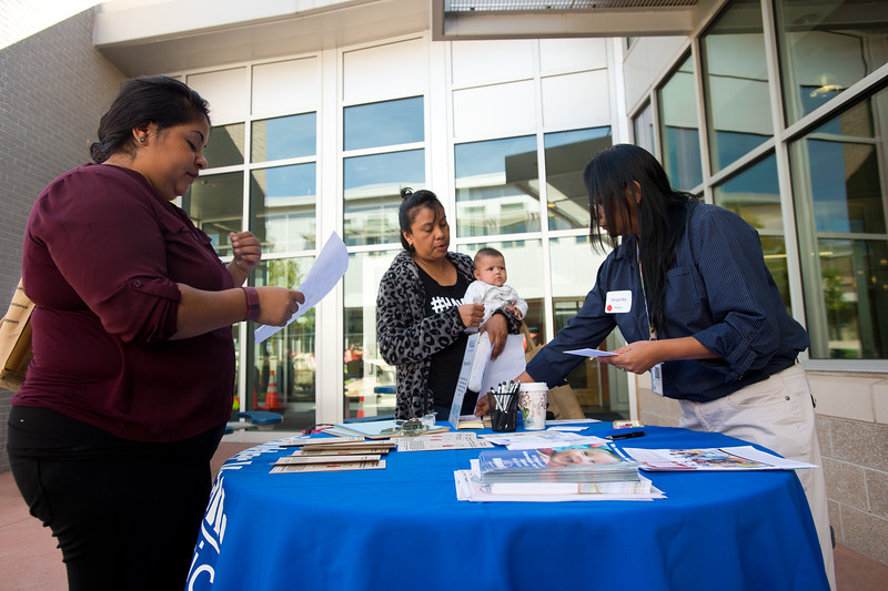 "Margarita Nava (right) talks with Clara Garcia (center) about the Child Find program for Boulder Valley School District during the Resource Fair at the Latino Parent Summit at Casey Middle School in Boulder on Saturday. <br /> More photos:  <a href=""http://www.dailycamera.com"">http://www.dailycamera.com</a><br /> (Autumn Parry/Staff Photographer)<br /> October 8, 2016"