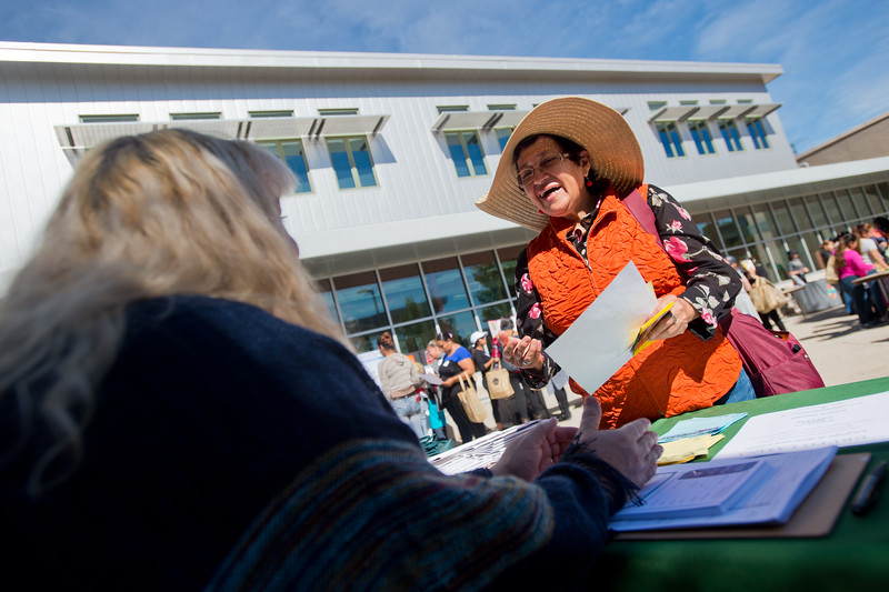 "Elvia Villalobos talks with a vendor during the Resource Fair at the Latino Parent Summit at Casey Middle School in Boulder on Saturday. <br /> More photos:  <a href=""http://www.dailycamera.com"">http://www.dailycamera.com</a><br /> (Autumn Parry/Staff Photographer)<br /> October 8, 2016"
