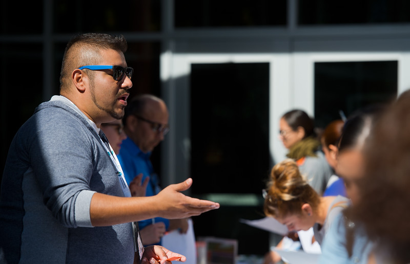 "Eric Alvarez, with FRC and Boulder County Housing and Human Services, speaks with visitors during the Resource Fair at the Latino Parent Summit at Casey Middle School in Boulder on Saturday. <br /> More photos:  <a href=""http://www.dailycamera.com"">http://www.dailycamera.com</a><br /> (Autumn Parry/Staff Photographer)<br /> October 8, 2016"