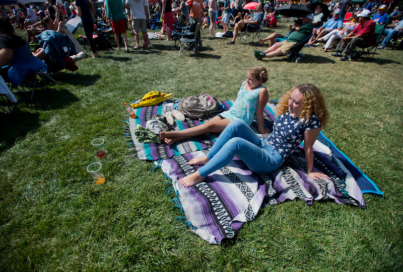 "Kalynn Rose Hubbard (right) sits with her half-sister Vienna Rollings, as they listen to music by the Denver Dream Police, a Cheap Trick cover band, during the Mile High Tribute Band Competition at Leftapalooza in Roosevelt Park in Longmont on Saturday. Left Hand Brewing Company's event raised funds and support for the Leukemia & Lymphoma Society and the Left Hand Brewing Foundation.<br /> More photos:  <a href=""http://www.dailycamera.com"">http://www.dailycamera.com</a><br /> (Autumn Parry/Staff Photographer)<br /> August 6, 2016"