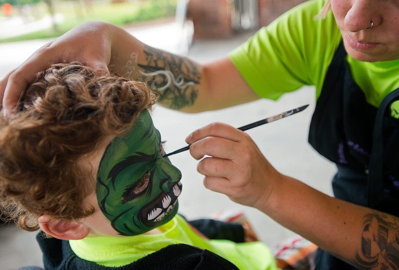 "Owen Golliher, 6, holds still as he has his face painted during Leftapalooza in Roosevelt Park in Longmont on Saturday. Left Hand Brewing Company's event raised funds and support for the Leukemia & Lymphoma Society and the Left Hand Brewing Foundation.<br /> More photos:  <a href=""http://www.dailycamera.com"">http://www.dailycamera.com</a><br /> (Autumn Parry/Staff Photographer)<br /> August 6, 2016"