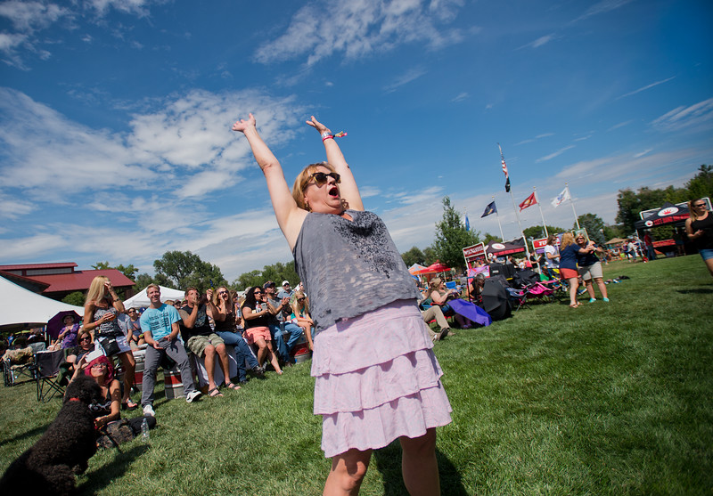 "Sarah Acker dances to music by the Denver Dream Police, a Cheap Trick tribute band, during the Mile High Tribute Band Competition at Leftapalooza in Roosevelt Park in Longmont on Saturday. Left Hand Brewing Company's event raised funds and support for the Leukemia & Lymphoma Society and the Left Hand Brewing Foundation.<br /> More photos:  <a href=""http://www.dailycamera.com"">http://www.dailycamera.com</a><br /> (Autumn Parry/Staff Photographer)<br /> August 6, 2016"