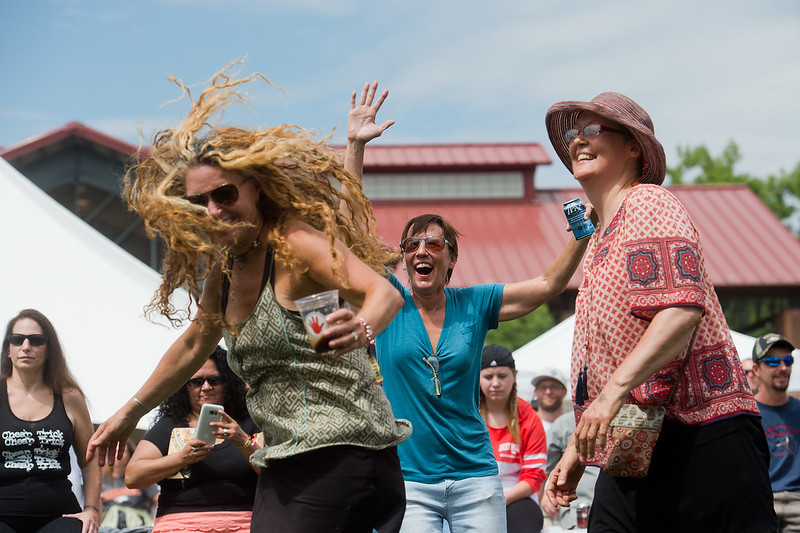 "Kit Kern (center) dances with Jae Maurice (left) to music by Shakedown Street, a Grateful Dead cover band, during Leftapalooza in Roosevelt Park in Longmont on Saturday. Left Hand Brewing Company's event raised funds and support for the Leukemia & Lymphoma Society and the Left Hand Brewing Foundation.<br /> More photos:  <a href=""http://www.dailycamera.com"">http://www.dailycamera.com</a><br /> (Autumn Parry/Staff Photographer)<br /> August 6, 2016"