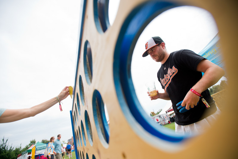 "Chris Dolch plays Connect Four with his mom, Jenn Dolch, during Leftapalooza in Roosevelt Park in Longmont on Saturday. Left Hand Brewing Company's event raised funds and support for the Leukemia & Lymphoma Society and the Left Hand Brewing Foundation.<br /> More photos:  <a href=""http://www.dailycamera.com"">http://www.dailycamera.com</a><br /> (Autumn Parry/Staff Photographer)<br /> August 6, 2016"