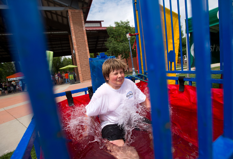 "Brody Wood, 12, falls into First National Bank's dunk tank during Leftapalooza in Roosevelt Park in Longmont on Saturday. Left Hand Brewing Company's event raised funds and support for the Leukemia & Lymphoma Society and the Left Hand Brewing Foundation.<br /> More photos:  <a href=""http://www.dailycamera.com"">http://www.dailycamera.com</a><br /> (Autumn Parry/Staff Photographer)<br /> August 6, 2016"